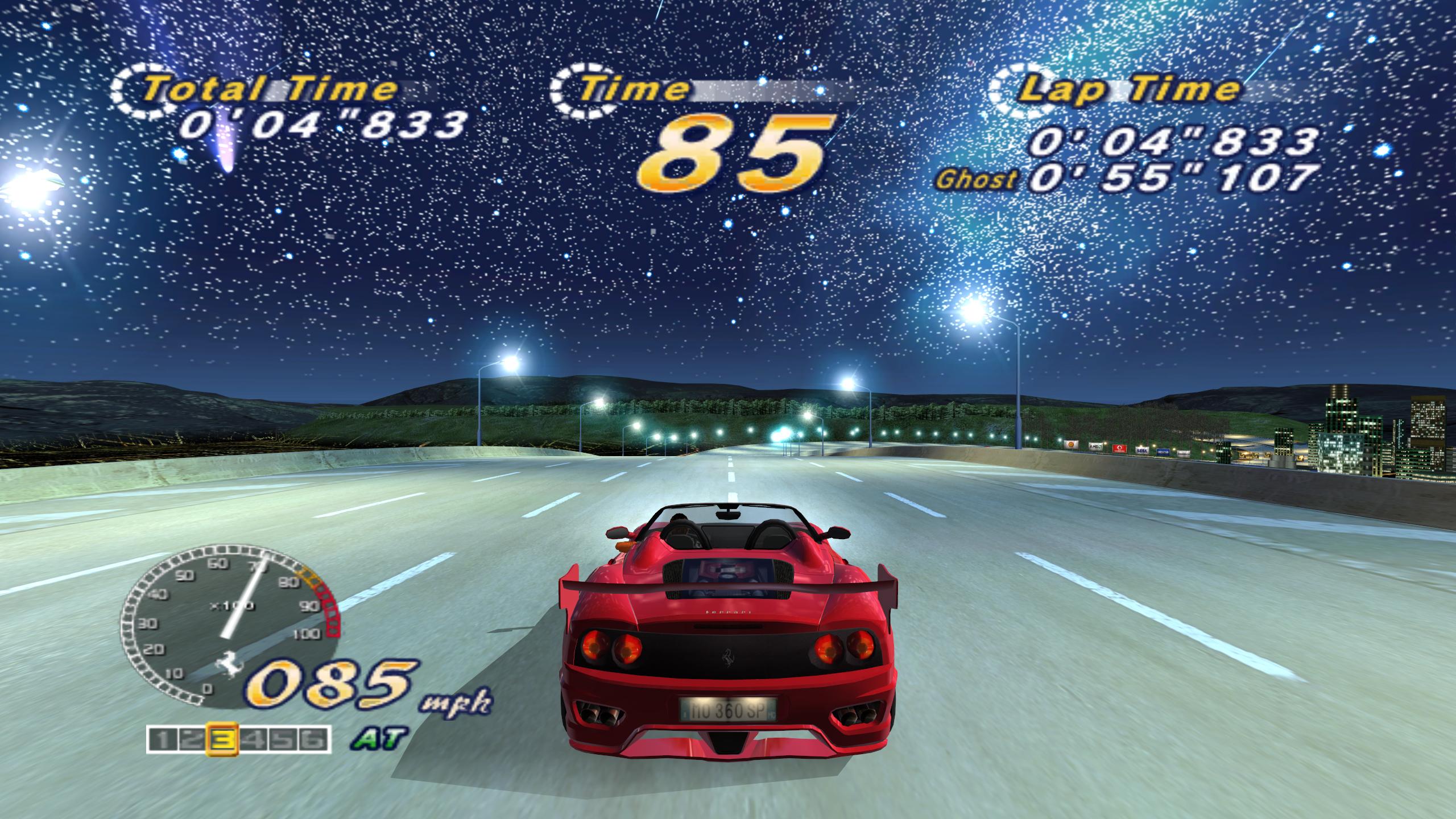 Ferrari driving on a road at night