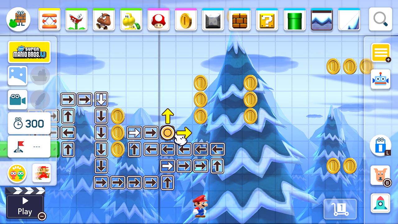 Mario befinner sig i en vinter-bana med snötäckta träd. Skärmen ramas in av editor-funktionerna. En pekar-hand placerar ut riktningspilar för en funktion på banan.