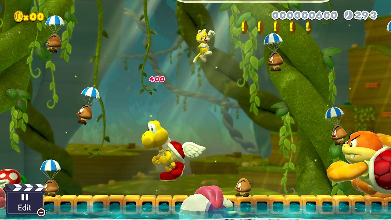 Mario har en gul katt-dräkt på sig, och hoppar genom en djungelbana med fallskärmshoppande goombas, flygande jätte-koopatroopas och andra fiender.